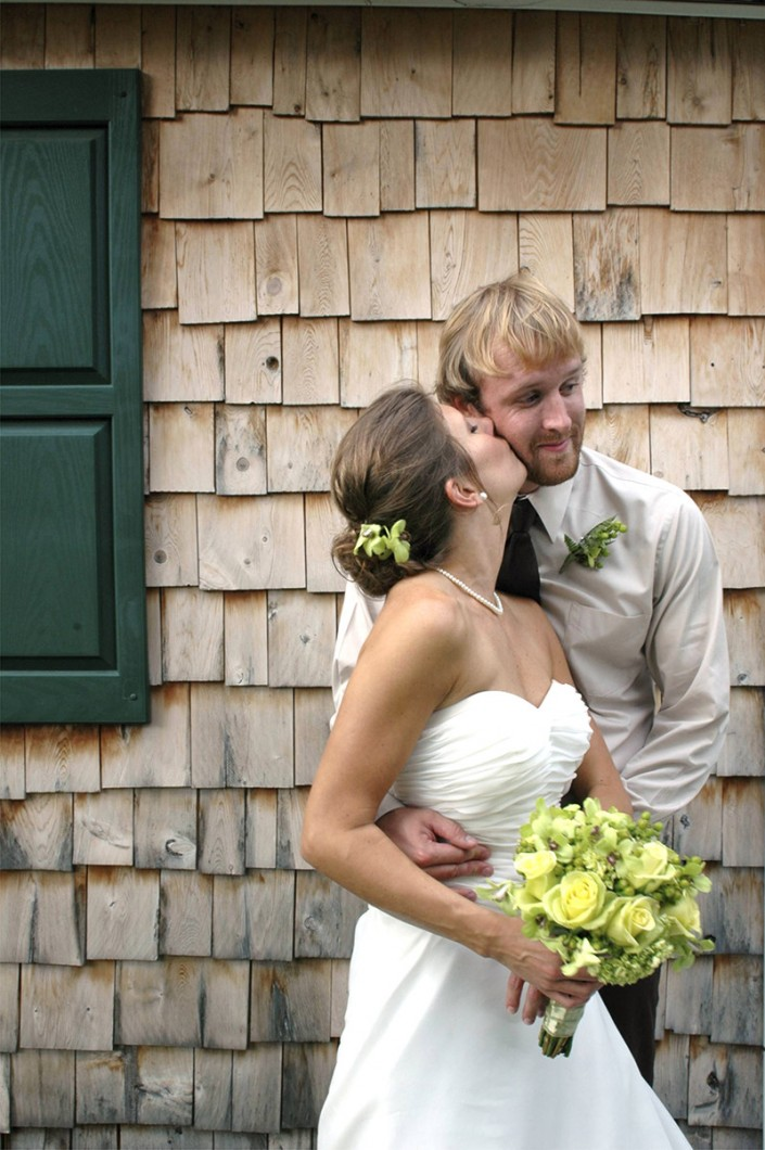 Bride and Groom Barn Kiss